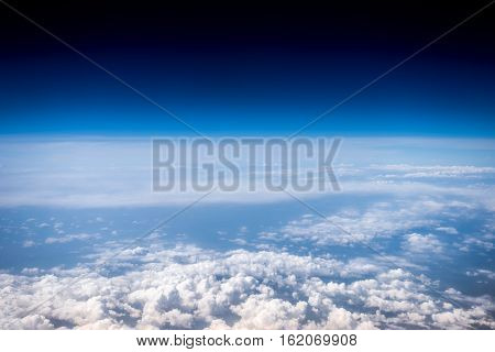 Fluffy white clouds and blue sky. Stratosphere. View from above.