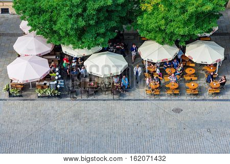 KRAKOW POLAND - OCTOBER 02: This is an aerial view of cafes in Krakow old town city center on October 02 2016 in Krakow