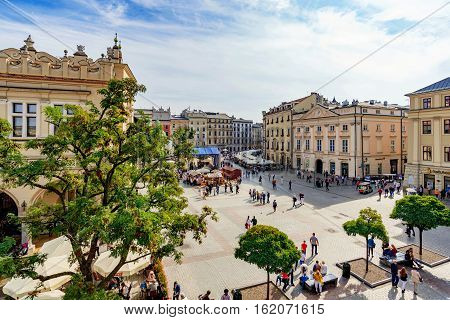 KRAKOW POLAND - OCTOBER 02: This is a view of Krakow old town square where you can see traditional polish architecture on October 02 2016 in Krakow