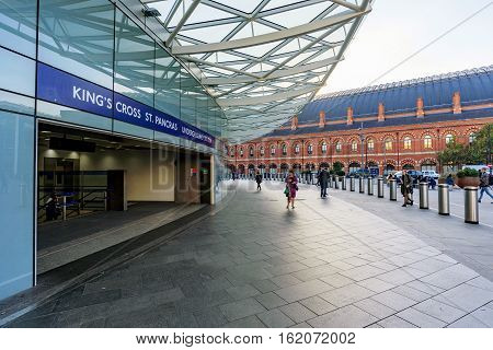 LONDON UNITED KINGDOM - OCTOBER 31: This is one of the main entrances to Kings Cross St Pancras underground station with Kings Cross international station in the distance on October 31 2016 in London