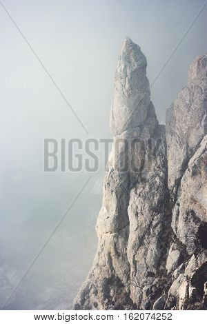Foggy rocky Mountains cliff Landscape minimalistic style Travel serene scenic aerial view moody weather
