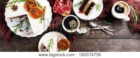 Pieces of delicious chocolate cake with orange jam covered with cheese cream. Christmas dinner concept. Selective focus. Top view. Copy space.