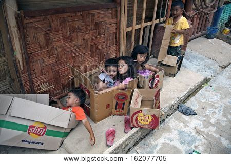 BUKIT LAWANG INDONESIA - AUGUST 18, 2012: Playing children sitting in a box