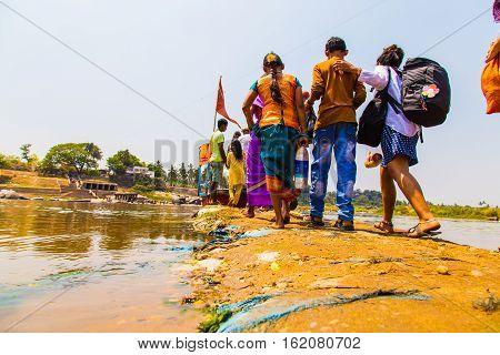 People crossing the river, Hampi, Karnataka, India