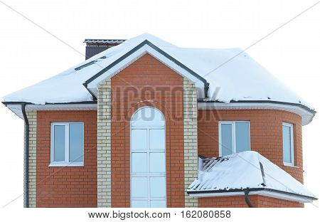 isolated brick apartment house with a snow-covered roof