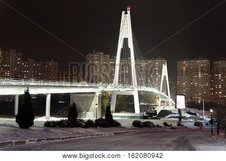 Moscow Russia - December 10.2016. Pedestrian cable-stayed bridge at night in a Krasnogorsk