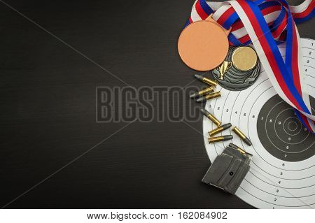 Shooting competition. Award winners. Biathlon victory. Ammunition and winners medals in biathlon. Diploma of shooting competitions. Background diploma.