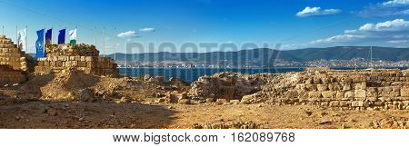 Nesebar Bulgaria - August 30 2013: Ancient ruins and the remains of an old fortress wall in the old town of Nessebar on the Black Sea coast. UNESCO world heritage site. Panoramic shot.