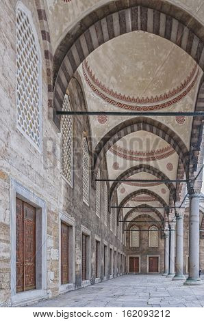 One of the colonnaded arcades by the courtyard of the blue mosque in Istanbul Turkey.