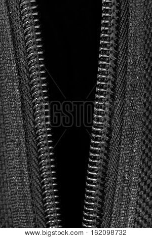 closeup open zipper and canvas texture in dark tone