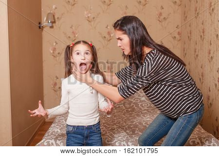 Mother trying to strangle her little daughter.