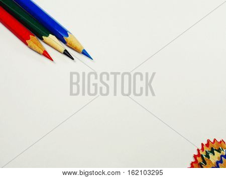 colored pencils and pencil sharpener on a white background