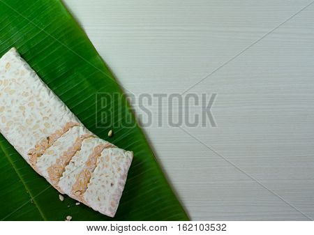 closeup soybean tempeh in banana leaves, food from Indonesia