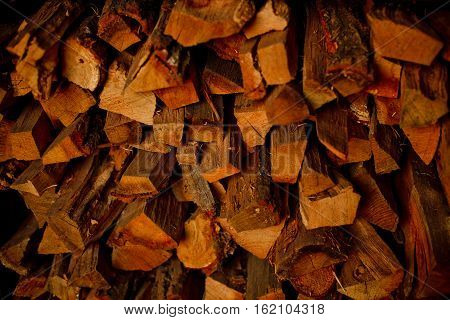 Background of dry chopped logs in a pile