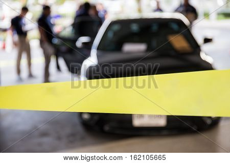police line protect vehicle in crime scene investigation training in academy with blurred law enforcement background and space for text on yellow line