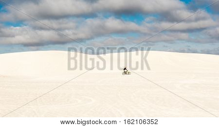 Dune bike rider at the Lancelin sand dunes near Perth in Western Australia