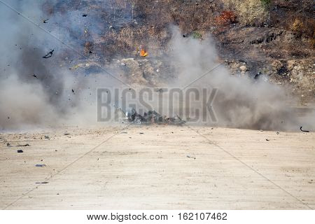 smoke and movement of car part blown away from explosion in post blast investigation course training