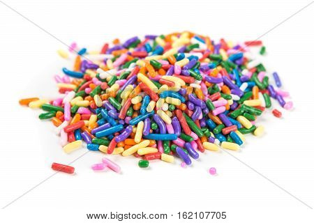 Assorted Rainbow Colored Sprinkles Isolated On White Background