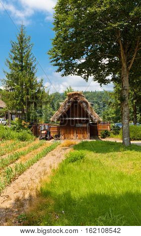 OGIMACI JAPAN - AUGUST 01 2016: Former Yamamo Fumishiro family stable (moved from Magari area circa 19th c.) in Ogimachi gassho style village of Shirakawa-go district. UNESCO site