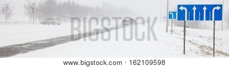 Cars on winter road in a snowstorm and bad visibility, border design panoramic banner