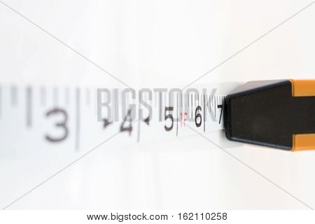 numeric and scale on measuring tape for forensic in crime scene isolated on white background