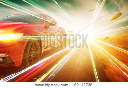 Red race car with light effect running on road.