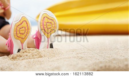 People, Sports And Healthy Lifestyle. Close Up View Of Soles Of Female Running Shoes. Young Sportswo