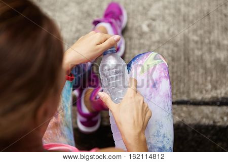 Stylish Young Female Athlete In Sportswear Holding Plastic Bottle Of Drinking Water, Opening It, Pre