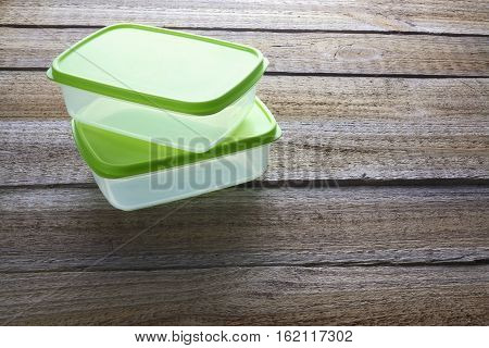 Stack of Lunch Boxes on Wooden Background