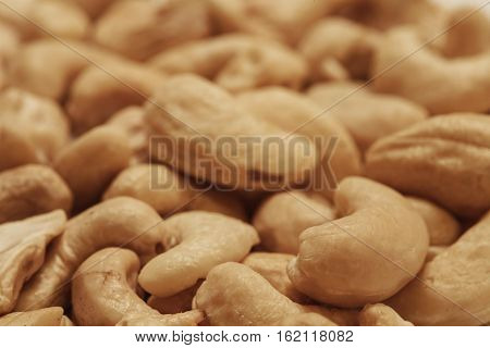 Cashew nuts pile closeup, food macro photo