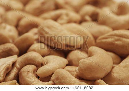 Cashew nuts pile closeup, food macro photo