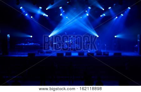 Perfect bluered background with blue concert lights big stage. Electronic music concept.