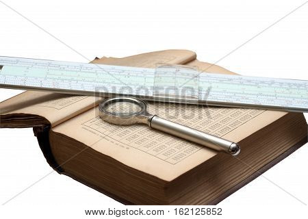 Handbook of mathematics; magnifying glass and a slide rule isolated on white background. Obsolete things for school and work.