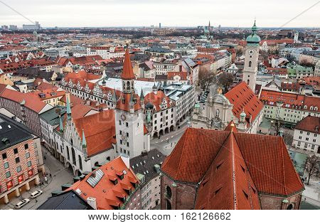 Aerial view over the roofs of Munich Old Town Hall and Heiliggeistkirche. Germany