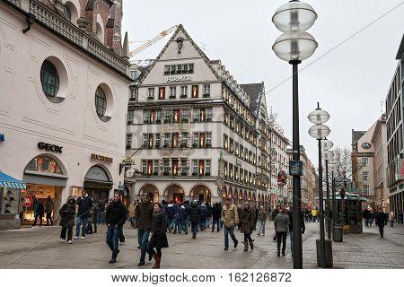 MUNICH GERMANY - JANUARY 01 2011 - Many people walking on a pedestrian street in the center of Munich