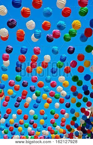 Paper Lanterns on blue sky background at the celebration in Ronda, Malaga (Andalusia), Spain.