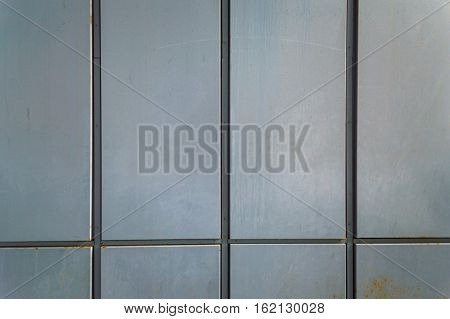 Close up of a corrugated gray metal siding panel