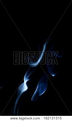 Blue abstract smoke art plume going up and down on a black background vertical view