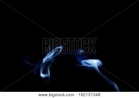 Blue abstract smoke art plume going from right to left on a black background