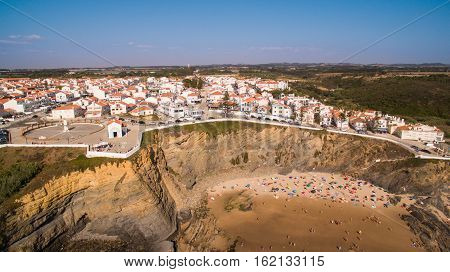 Panoramic view of Zambujeira de Mar and beach with holidaymakers people