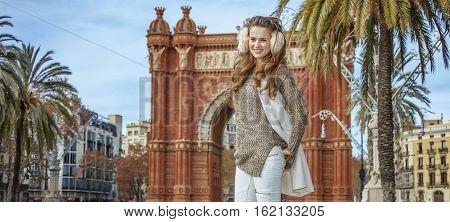 Happy Young Woman In Earmuffs In Barcelona, Spain