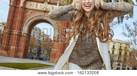 Cheerful Young Fashion-monger In Earmuffs In Barcelona, Spain