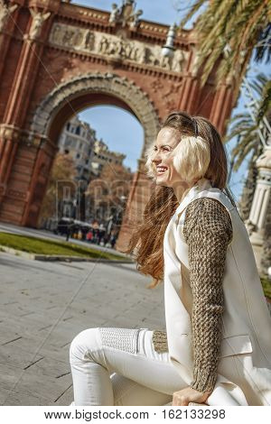 Elegant Fashion-monger Near Arc De Triomf Sitting On Parapet