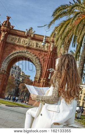 Woman Near Arc De Triomf In Barcelona, Spain Looking At Map