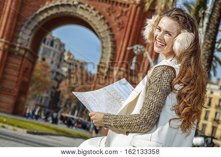 Happy Woman Near Arc De Triomf In Barcelona, Spain With Map