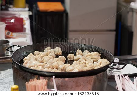 Fried Mongolian Dumpling With Meat At Christmas Market