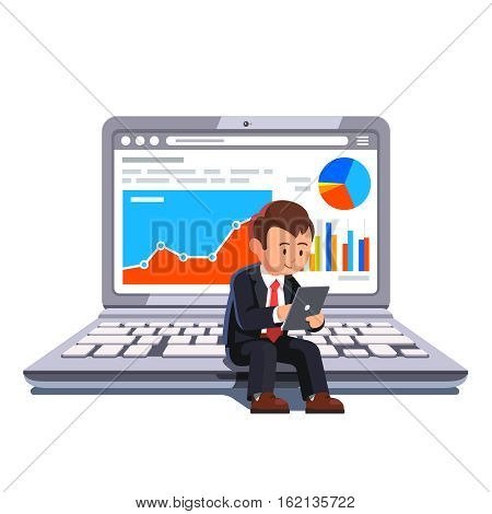 Small businessman sitting on a big laptop showing statistical business data and browsing on a tablet his holding in hands. Flat style concept vector illustration.