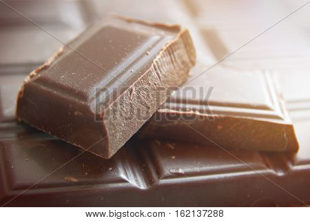 A pile of ounces of sweet dark chocolate