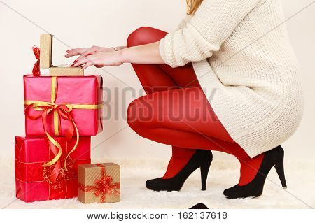 Woman With Many Gift Boxes Opening Golden Box With Jewel Pearls