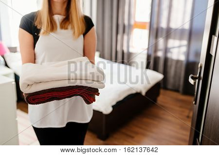Maid Bringing Fresh Clean Towels To The Room